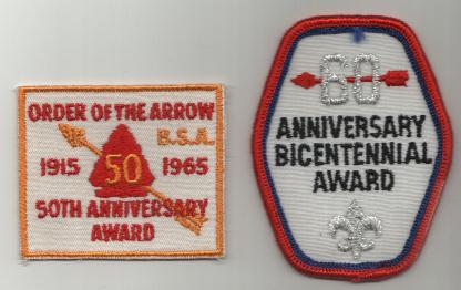 the 50th and the 60th Anniversary sash emblems