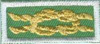 Girl Scout First Class/Gold Award knot emblem