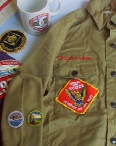 Merit Badges are worn close to the end of the right arm