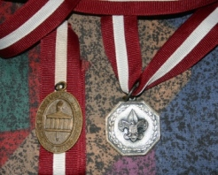EKU's Silver Scouter Award (right) and the University's Acheivement Medallion (left, presented until 1980) were presented along with a certificate to receipients